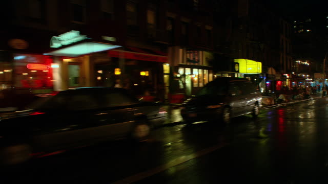 vídeos de stock, filmes e b-roll de ts / rear passenger 45' driving around the upper east side of new york city at night / new york - placa de processo