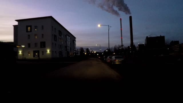 driving at dusk through industrial and residential area of oulu, finland - industrial district stock videos & royalty-free footage