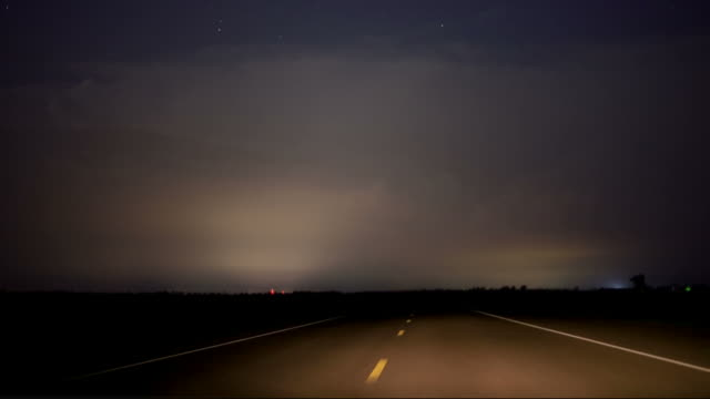 driving at night during a thunderstorm - thunderstorm stock videos and b-roll footage