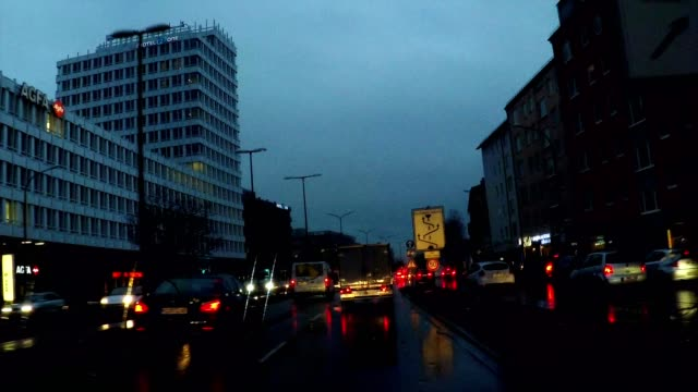 driving at night in the rain on a highway through downtown munich, germany - high point video stock e b–roll