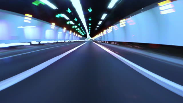 Driving at night in tunnel with long exposure light effect.