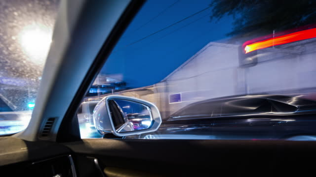 t/l pov driving at night on a highway - wing mirror stock videos & royalty-free footage