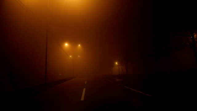driving at night through fog - headlight stock videos & royalty-free footage