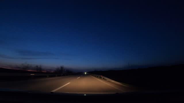 pov driving at night - winding road stock videos & royalty-free footage