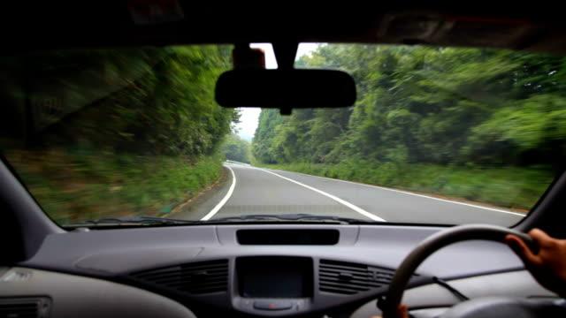 Driving at rainy mountain road.