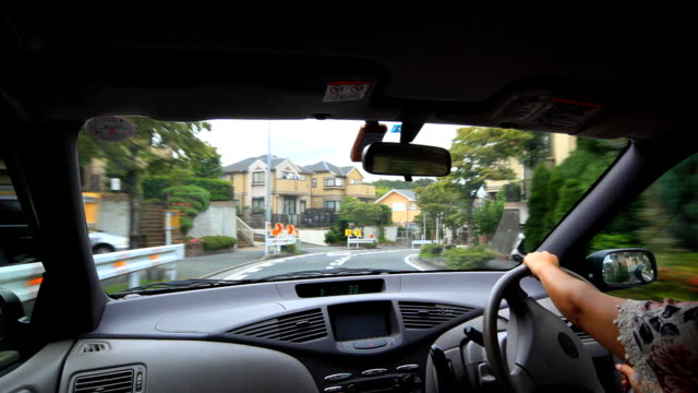 driving at residential street - dashboard stock videos & royalty-free footage