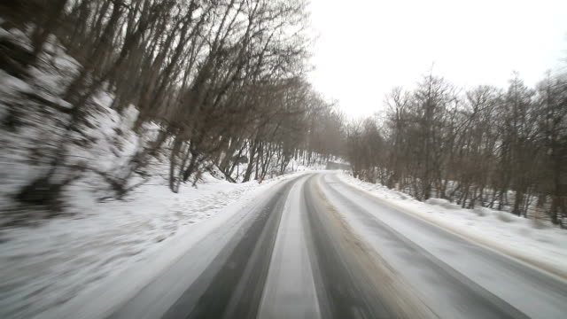 driving at snow road - plusphoto stock videos & royalty-free footage
