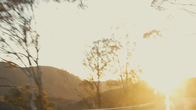 pov driving at sunset on curvy road - car interior stock videos & royalty-free footage