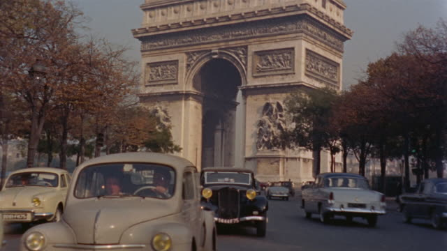 stockvideo's en b-roll-footage met ws rear pov driving away from arc de triomphe / paris, france - 1955