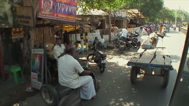 ms pov driving behind ox drawn carriage on street, pondicherry, india - 牛車点の映像素材/bロール
