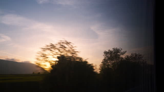 driving by landscapes at sunrise - moving past stock videos & royalty-free footage