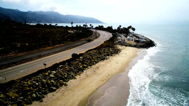 rv driving by on the pacific coast highway aerial drone view - route 001 stock videos & royalty-free footage