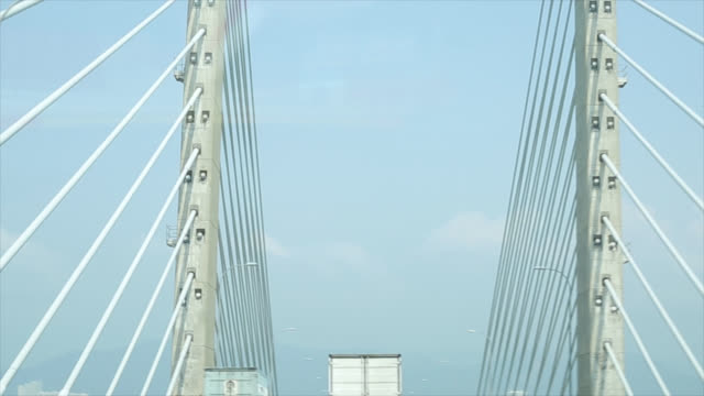 driving car cross over penang bridge - penang stock videos and b-roll footage