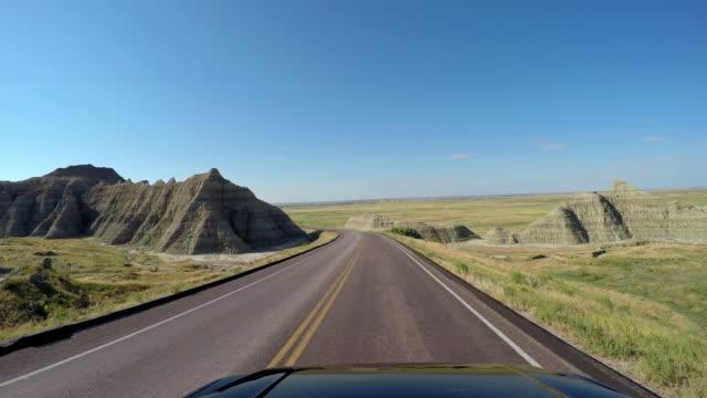 pov driving car highway badlands south dakota usa - south dakota stock-videos und b-roll-filmmaterial