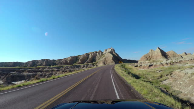 pov driving car highway badlands south dakota usa - great plains stock videos & royalty-free footage