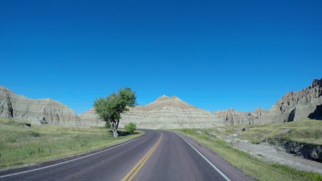 POV driving car Highway Badlands South Dakota USA