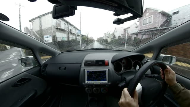 driving car in rainy day / residential district - plusphoto stock videos & royalty-free footage
