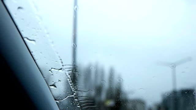 slow mot - driving car in the rain - headlight stock videos & royalty-free footage