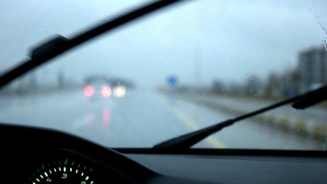 driving car in the rain - car point of view stock videos and b-roll footage