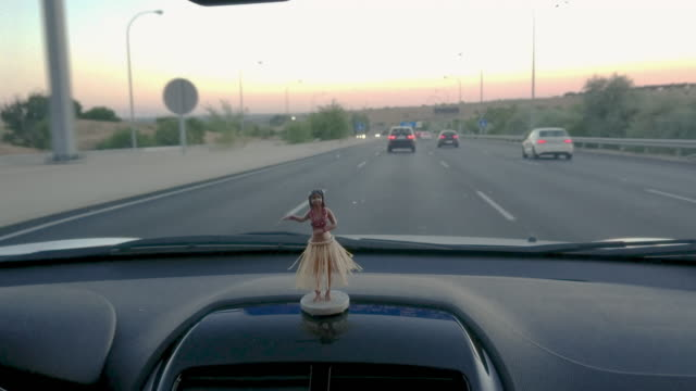 driving car interior with a hawaian dancer doll - doll stock videos & royalty-free footage