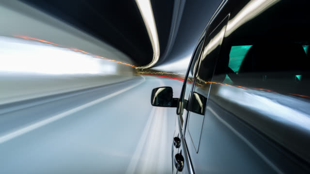 pov - driving car - on board long exposure time lapse - part 1-4: early morning - left side of the car with side mirror in frame - van vehicle stock videos and b-roll footage