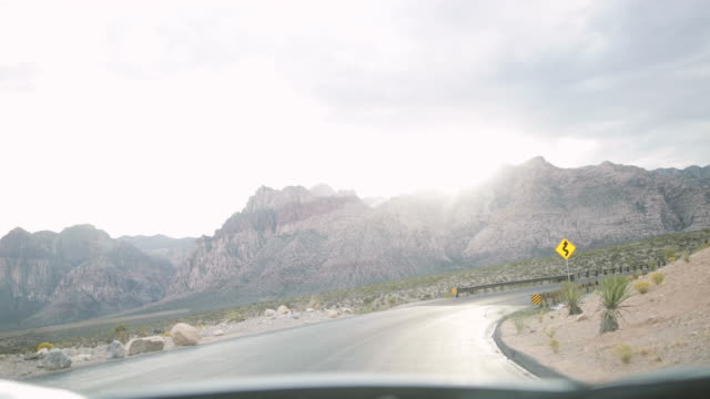 pov driving car on road in scenic landscape - nevada stock-videos und b-roll-filmmaterial