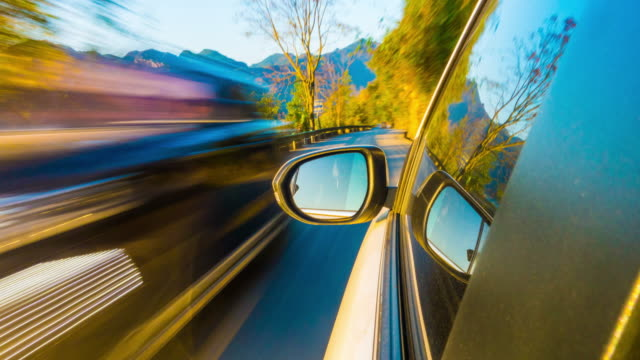 driving car on road - electric vehicle stock videos & royalty-free footage