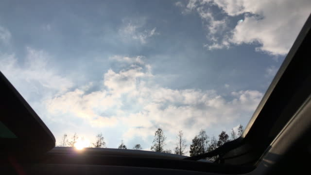 driving car past wind power farm - sun roof stock videos & royalty-free footage