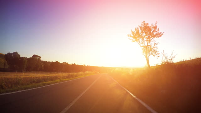 "driving car point of view ""bei sonnenuntergang - motorrad stock-videos und b-roll-filmmaterial"