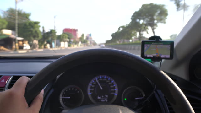 driving car with gps front view at sunset, driving - taxi driver stock videos and b-roll footage