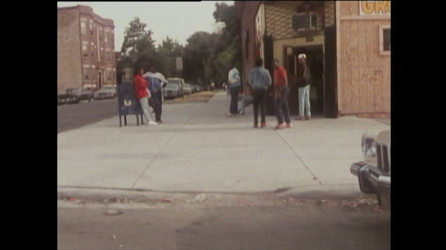 driving pov of chicago streets and children from gangs; 1989 - gang stock videos & royalty-free footage