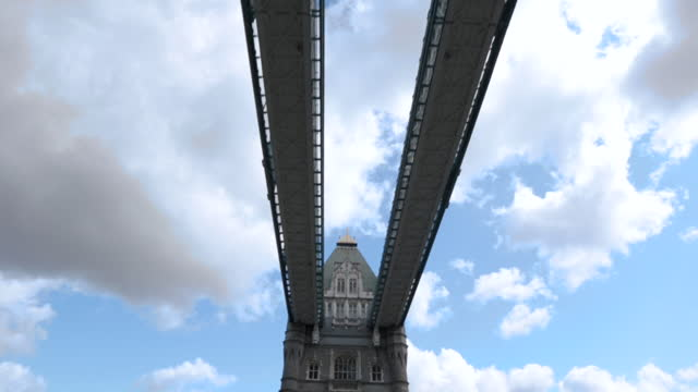 driving pov crossing tower bridge in london and looking up at the gothic architecture and walkways. - international landmark stock videos & royalty-free footage