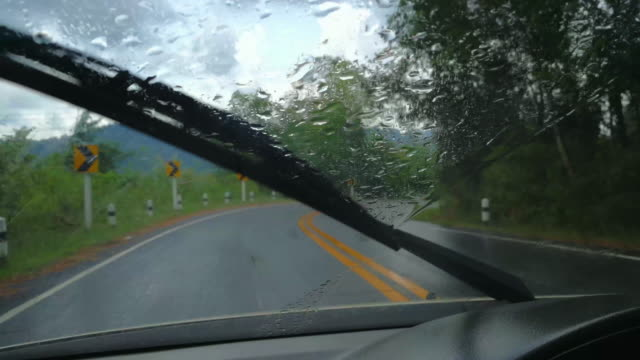 driving curve road in the rain shot on smart phone - hill stock videos & royalty-free footage