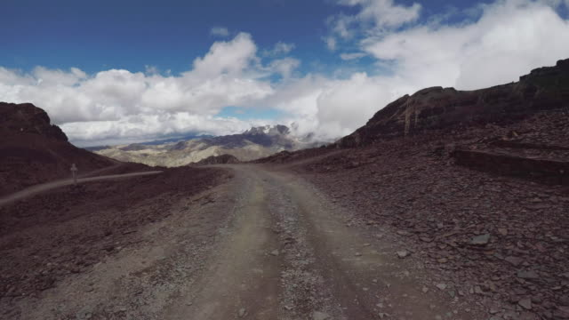 pov driving down a gravel road in the andean mountains - ecuador stock-videos und b-roll-filmmaterial