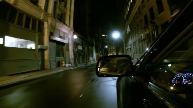 Driving down a narrow urban street