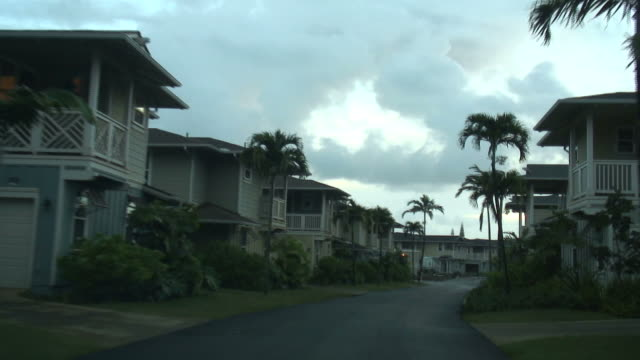 (hd1080i) driving down a residential street - tract housing stock videos and b-roll footage