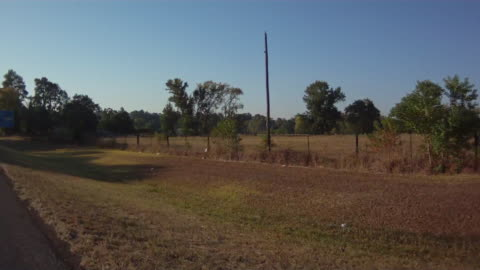 """driving down a rural texas highway, passing a road sign reading, """"welcome to carthage best small town in texas."""" - welcome sign stock videos & royalty-free footage"""