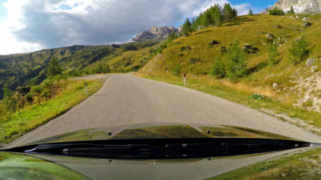 driving down a winding mountain road - mgost stock videos and b-roll footage