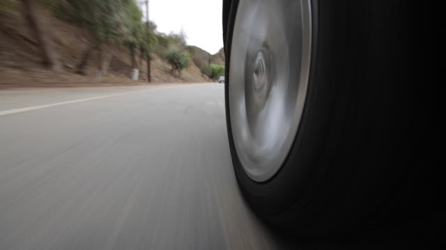 rear pov driving down asphalt road from car point of view / los angeles, california, united states - tyre stock videos & royalty-free footage