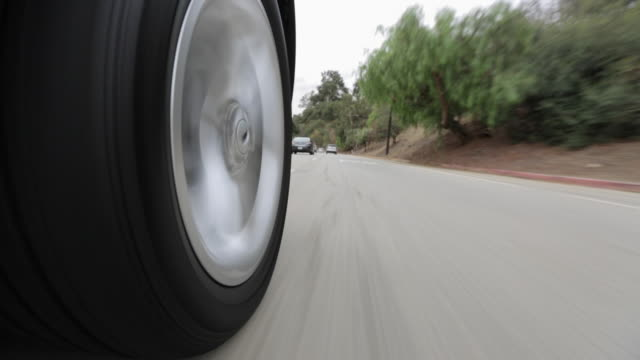 pov driving down asphalt road / los angeles, california, united states - tyre stock videos and b-roll footage