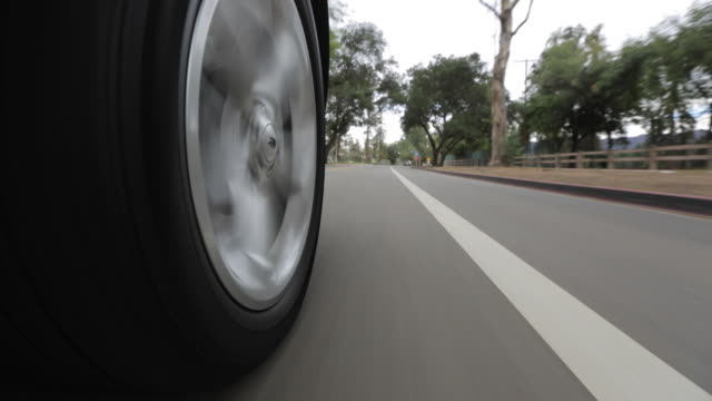 pov driving down asphalt road / los angeles, california, united states - reifen stock-videos und b-roll-filmmaterial