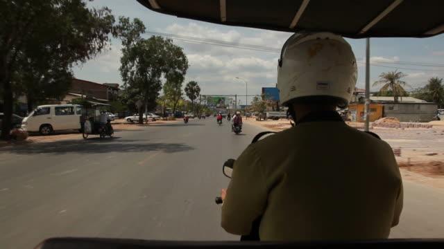 POV WS Driving down Cambodian town street / Angkor Wat, Siem Reap, Cambodia