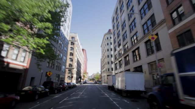 driving down city side streets - urban road stock videos & royalty-free footage