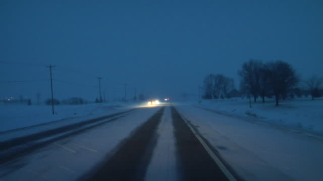 WS T/L CAR POV Driving down country road in snowstorm/ Hortonville, Wisconsin