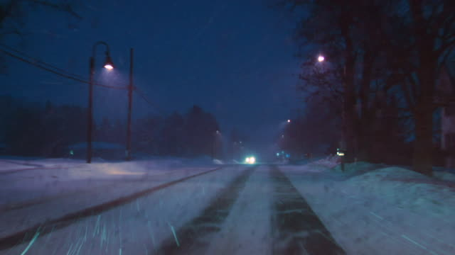 ws car pov driving down country road in snowstorm/ hortonville, wisconsin - snow stock videos & royalty-free footage