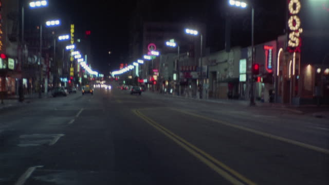 vidéos et rushes de ws rear pov driving down hollywood blvd at night / hollywood, california, usa - hollywood boulevard