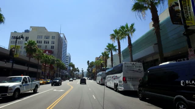 vidéos et rushes de driving down hollywood boulevard 4k transportation - hollywood boulevard