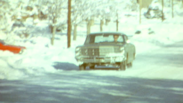 driving down icy road / snow covered homes / siblings walk / icicles / winter memories on february 01, 1976 in farmington, utah - utah stock videos & royalty-free footage
