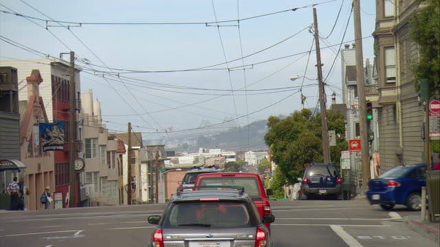 pov driving down north point street with oakland bay bridge in distance, san francisco, california, usa - trolleybus stock-videos und b-roll-filmmaterial