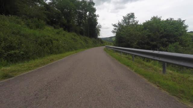 pov driving down rural road - blocco stradale video stock e b–roll